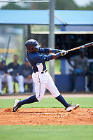 GCL Rays left fielder Tony Pena (24) follows through on a swing during the first game of a doubleheader against the GCL Twins on July 18, 2017 at Charlotte Sports Park in Port Charlotte, Florida.  GCL Twins defeated the GCL Rays 11-5 in a continuation of a game that was suspended on July 17th at CenturyLink Sports Complex in Fort Myers, Florida due to inclement weather.  (Mike Janes/Four Seam Images)