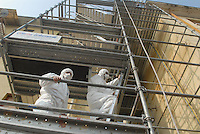 - Casale Monferrato, cantiere per la rimozione della polvere di amianto usata come materiale isolante nei soffitti di un palazzo in centro città<br /> <br /> - Casale Monferrato, yard for the removal of asbestos dust used as insulating material in the ceiling of a palace in the city centre