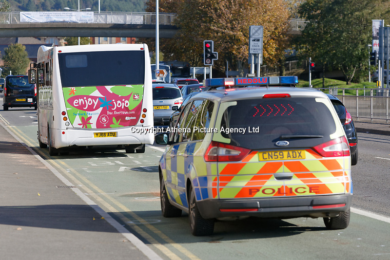 Pictured: The bus involved in the incident on Oystermouth Road, Swansea, Wales, UK. Thursday 18 October 2018<br /> Re: A woman has been airlifted to hospital with serious injuries after she was hit by a bus in Swansea on Thursday morning, police have said.<br /> Oystermouth Road was closed in both directions to allow the air ambulance to land.<br /> The woman was taken to University Hospital of Wales in Cardiff.<br /> South Wales Police is appealing for information and the westbound carriageway is expected to remain closed for several hours.