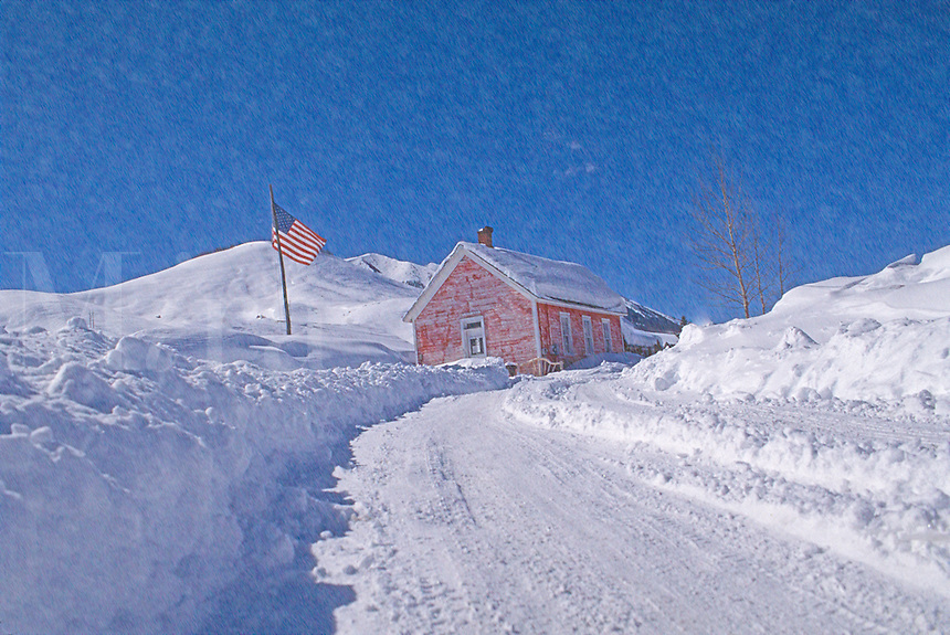.Rural house in snow storm.
