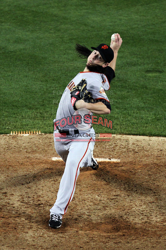 San Francisco Giants pitcher Tim Lincecum #55 pitches against the Los Angeles Dodgers at Dodger Stadium on September 20, 2011 in Los Angeles,California. Los Angeles defeated San Francisco 2-1.(Larry Goren/Four Seam Images)