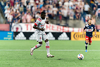 FOXBOROUGH, MA - JULY 7: Kemar Lawrence #92 of Toronto FC passes the ball during a game between Toronto FC and New England Revolution at Gillette Stadium on July 7, 2021 in Foxborough, Massachusetts.