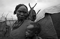 Mornei IDP camp, West Darfur, August 8, 2004.Faday Ahmad Adam and her son Kamal Baker are among more than 75 000 IDP's living in this huge camp.