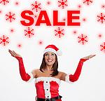 USA, Illinois, Metamora, Woman wearing Santa costume looking at sale sign