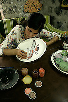Painting a faravahar, the zoroastrian symbol, onto a ceramic at Nur Cin at the Pasha Han, Diyarbakir, southeastern Turkey