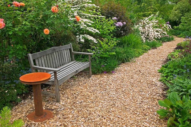 Chip wood path and bench at Northwest Garden Nursery, Eugene, Oregon