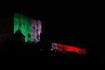 Europe Virus Outbreak  in Pergine Valsugana, Italy on April 9, 2020. A sweeping lockdown is in place in Italy to try to slow down the spread of coronavirus epidemic. For most people, the new coronavirus causes only mild or moderate symptoms. Pergine's castle is lighted with the colours (green, White, red) of the Italian Flag some days before Easter.