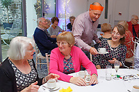 Pictured: Guests are being served drinks by one of the lottery winners.  Wednesday 28 November 2018<br /> Re: National Lottery millionaires from south Wales and the south west of England have hosted a glitzy Rat Pack-inspired Christmas party for an older people's music group at The Bear Hotel in Cowbridge, Wales, UK.