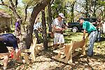 Volunteers building lots of benches