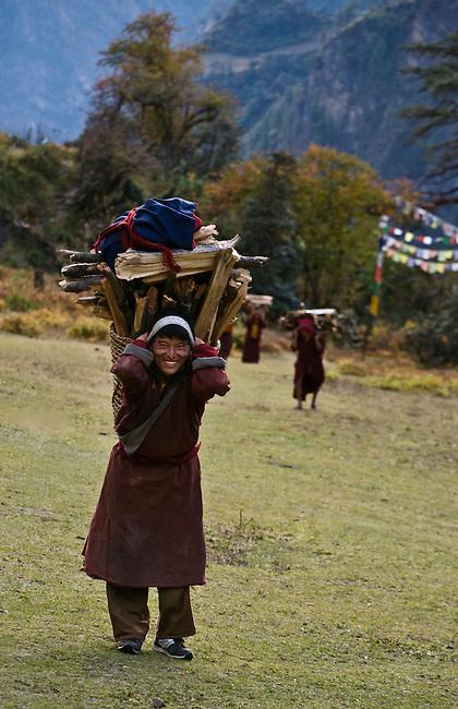 A MONK hauls FIREWOOD to his remote TIBETAN BUDDHIST MONASTERY - NEPAL