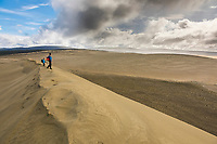 Two hikers view The great sand dunes in the Kobuk Valley National Park, Arctic, Alaska.
