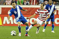U.S defender Steve Cherundolo (6) beats Marco Pappa to the ball..USMNT defeated Guatemala 3-1 in World Cup qualifying play at LIVESTRONG Sporting Park, Kansas City, KS.