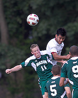 George Mason University forward/midfielder Timmy Mulgrew (11) and Boston College defender/forward Kevin Mejia (12) battle for head ball. Boston College defeated George Mason University, 3-2, at Newton Soccer Field, August 26, 2011.