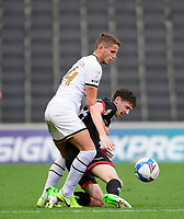 Lincoln City's Conor McGrandles battles with Milton Keynes Dons' Jordan Houghton<br /> <br /> Photographer Chris Vaughan/CameraSport<br /> <br /> The EFL Sky Bet League One - Milton Keynes Dons v Lincoln City - Saturday 19th September 2020 - Stadium MK - Milton Keynes<br /> <br /> World Copyright © 2020 CameraSport. All rights reserved. 43 Linden Ave. Countesthorpe. Leicester. England. LE8 5PG - Tel: +44 (0) 116 277 4147 - admin@camerasport.com - www.camerasport.com