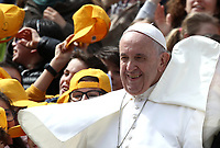 Papa Francesco posa per una foto con alcuni bambini al terminedell'udienza generale del mercoledi' in Piazza San Pietro, Citta' del Vaticano, 20 marzo 2019.<br /> Pope Francis poses for a photo  with chidren at the end of the weekly general audience in St. Peter's Square at the Vatican, on March 20, 2019.<br /> UPDATE IMAGES PRESS/Isabella Bonotto<br /> <br /> STRICTLY ONLY FOR EDITORIAL USE