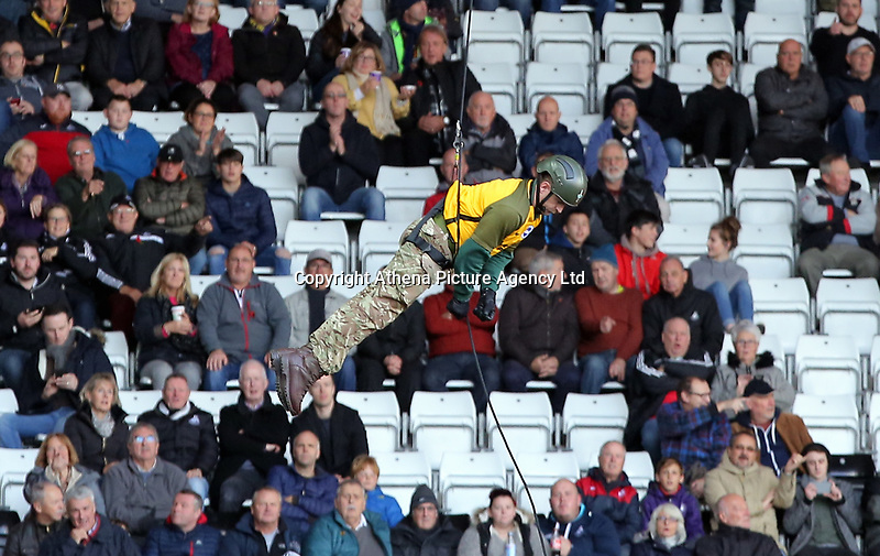 A member of the armed forces parasails from the stadium roof during the Premier League match between Swansea City and Brighton and Hove Albion at The Liberty Stadium, Swansea, Wales, UK. Saturday 04 November 2017