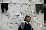 A young girl smiles as she heads to school in her uniform at an orphanage in Pokhara, Nepal.
