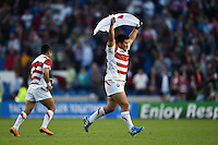 Kensuke Hatakeyama of Japan celebrates the win after the final whistle. Rugby World Cup Pool B match between South Africa and Japan on September 19, 2015 at the Brighton Community Stadium in Brighton, England. Photo by: Patrick Khachfe / Stewart Communications