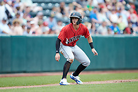Kevin Newman (3) of the Indianapolis Indians takes his lead off of third base against the Columbus Clippers at Huntington Park on June 17, 2018 in Columbus, Ohio. The Indians defeated the Clippers 6-3.  (Brian Westerholt/Four Seam Images)