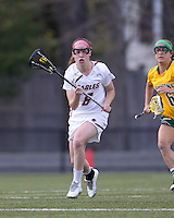 Boston College defender Kate Collins (6) brings the ball forward. Boston College defeated University of Vermont, 15-9, at Newton Campus Field, April 4, 2012.