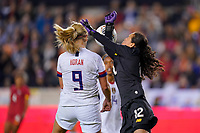 HOUSTON, TX - JANUARY 31: Lindsey Horan #9 of the United States heads a ball past GK Sasha Fabrega #12 of Panama during a game between Panama and USWNT at BBVA Stadium on January 31, 2020 in Houston, Texas.