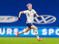 LE HAVRE, FRANCE - APRIL 13: Megan Rapinoe #15 of the USWNT sprints during a game between France and USWNT at Stade Oceane on April 13, 2021 in Le Havre, France.