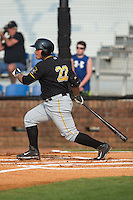 Carlos Munoz (22) of the Bristol Pirates follows through on his swing against the Johnson City Cardinals at Howard Johnson Field at Cardinal Park on July 6, 2015 in Johnson City, Tennessee.  The Pirates defeated the Cardinals 2-0 in game one of a double-header. (Brian Westerholt/Four Seam Images)