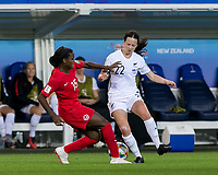 GRENOBLE, FRANCE - JUNE 15: Olivia Chance #22 of the New Zealand National Team attempts to control the ball as Nichelle Prince #15 of the Canadian National Team pressures during a game between New Zealand and Canada at Stade des Alpes on June 15, 2019 in Grenoble, France.