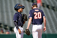 Pitcher Thatcher Hurd (20) talks with catcher Harry Ford (1) during the Baseball Factory All-Star Classic at Dr. Pepper Ballpark on October 4, 2020 in Frisco, Texas.  Pitcher Thatcher Hurd (20), a resident of Manhattan Beach, California, attends Mira Costa High School.  (Ken Murphy/Four Seam Images)