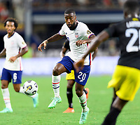 DALLAS, TX - JULY 25: Shaq Moore #20 of the United States attempts to gain control of a loose ball during a game between Jamaica and USMNT at AT&T Stadium on July 25, 2021 in Dallas, Texas.