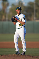 AZL Athletics starting pitcher Angello Infante (49) prepares to deliver a pitch during an Arizona League game against the AZL Giants Orange at Lew Wolff Training Complex on June 25, 2018 in Mesa, Arizona. AZL Giants Orange defeated the AZL Athletics 7-5. (Zachary Lucy/Four Seam Images)