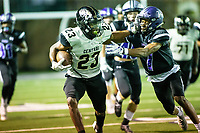 Sam Franklin (23) of  Little Rock Central stiff arms Owen Mccone (7) of Fayetteville aat Harmon Stadium, Fayetteville, Arkansas on Friday, November 13, 2020 / Special to NWA Democrat-Gazette/ David Beach