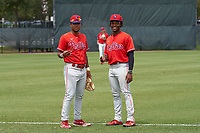 Philadelphia Phillies Marcus Lee Sang (left) and Jamari Baylor (right) before an Extended Spring Training game against the New York Yankees on June 22, 2021 at the Carpenter Complex in Clearwater, Florida. (Mike Janes/Four Seam Images)