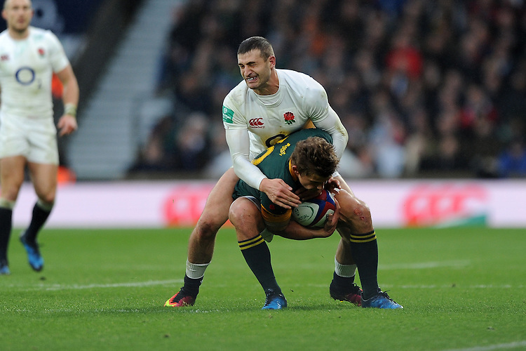 Jonny May of England tackles Pat Lambie of South Africa during the Old Mutual Wealth Series match between England and South Africa at Twickenham Stadium on Saturday 12th November 2016 (Photo by Rob Munro)