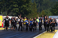 Aug. 4, 2013; Kent, WA, USA: Crew members for NHRA pro stock driver Vincent Nobile cheer their driver on during the Northwest Nationals at Pacific Raceways. Mandatory Credit: Mark J. Rebilas-USA TODAY Sports