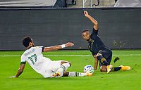 LOS ANGELES, CA - SEPTEMBER 13: Jeremy Ebobisse #17 of the Portland Timbers and Diego Palacios #12 of LAFC slide into one another during a game between Portland Timbers and Los Angeles FC at Banc of California stadium on September 13, 2020 in Los Angeles, California.