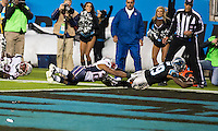 The Carolina Panthers play the New England Patriots at Bank of America Stadium in Charlotte North Carolina on Monday Night Football.  The Panthers defeated the Patriots 24-20.  Carolina Panthers wide receiver Ted Ginn (19) scores a touchdown over New England Patriots strong safety Logan Ryan (26)