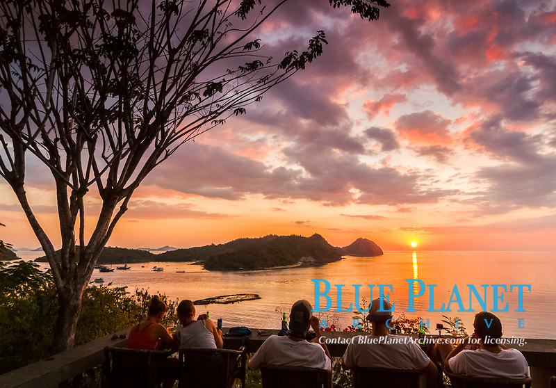tourists, ovserving sunset, Labuan Bajo, Flores, East Nusa Tenggara, Lesser Sunda Islands, Indonesia, Pacific Ocean