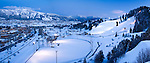A panoramic view of historic Howelsen hill looking towards the Steamboat ski area at dusk.