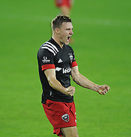 WASHINGTON, DC - OCTOBER 28: Julian Gressel #31 of D.C. United celebrates his score during a game between Columbus Crew and D.C. United at Audi Field on October 28, 2020 in Washington, DC.