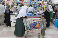 Tripoli, Libya - Al-Mehari Super Market, Grocery Store.  Libyan Mother and Son with Grocery Cart.