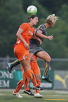 Sky Blue midfielder, Yael Averbuch (13), wins an aerial challenge against Philadelphia captain, Lori Lindsey (6).  The Philadelphia Independence scored three first half goals, and went on to win 4-1 over Sky Blue at John A Farrell Stadium in West Chester, Pennsylvania.