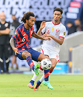 AUSTIN, TX - JULY 29: Gianluca Busio #6 of the United States and Homam Ahmed #14 of Qatar battle for control over a loose ball during a game between Qatar and USMNT at Q2 Stadium on July 29, 2021 in Austin, Texas.