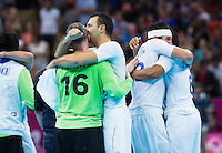 08 AUG 2012 - LONDON, GBR - French (FRA) players celebrate winning their men's London 2012 Olympic Games quarter final match against Spain at the Basketball Arena in the Olympic Park, in Stratford, London, Great Britain (PHOTO (C) 2012 NIGEL FARROW)