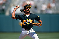 OAKLAND, CA - Dennis Eckersley of the Oakland Athletics pitches during a game at the Oakland Coliseum in Oakland, California in 1995. (Photo by Brad Mangin)