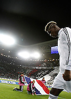 Calcio, Serie A: Juventus vs Milan. Torino, Juventus Stadium, 21 novembre 2015. <br /> Juventus' Paul Pogba enters the pitch for the Italian Serie A football match between Juventus and AC Milan at Turin's Juventus stadium, 21 November 2015. In background, children hold the French flag in homage to the victims of Paris' terrorist attacks.<br /> UPDATE IMAGES PRESS/Isabella Bonotto