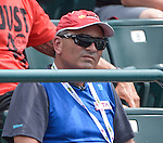 Nick Saviano, coach of  Eugenie Bouchard (CAN) watches as Bouchard defeats Jelena Jankovic (SrB) 6-3, 4-6, 6-3 at the Family Circle Cup in Charleston, South Carolina on April 4, 2014.