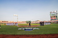 The North Carolina State Wolfpack and North Carolina Tar Heels baseball teams line up for the National Anthem before Game 10 of the College World Series on June 20, 2013 at TD Ameritrade Park in Omaha, Nebraska. (Andrew Woolley/Four Seam Images)