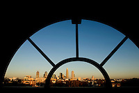The uptown Charlotte is framed between architectural detailing during sunrise in Charlotte, N.C.