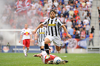 Diego Ribas da Cunha (28) of Juventus F. C. hurrdles the tackle of Sinisa Ubiparipovic (8) of the New York Red Bulls. The New York Red Bulls defeated Juventus F. C. 3-1 during a friendly at Red Bull Arena in Harrison, NJ, on May 23, 2010.
